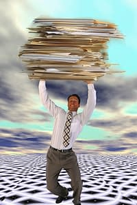 Businessman Carrying Giant Files