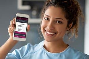 Caregiver showing off the app