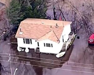 Flyover photo of Linda McMullen's home after a flood