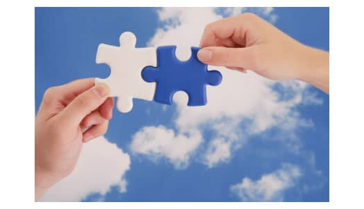Matching puzzle pieces against a sky background